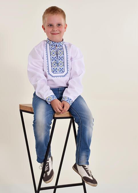 Вишиванка для хлопчика Молодший Капрал Плюс (біла з синім) – купити в УкраїнівідГаличанка фото 1